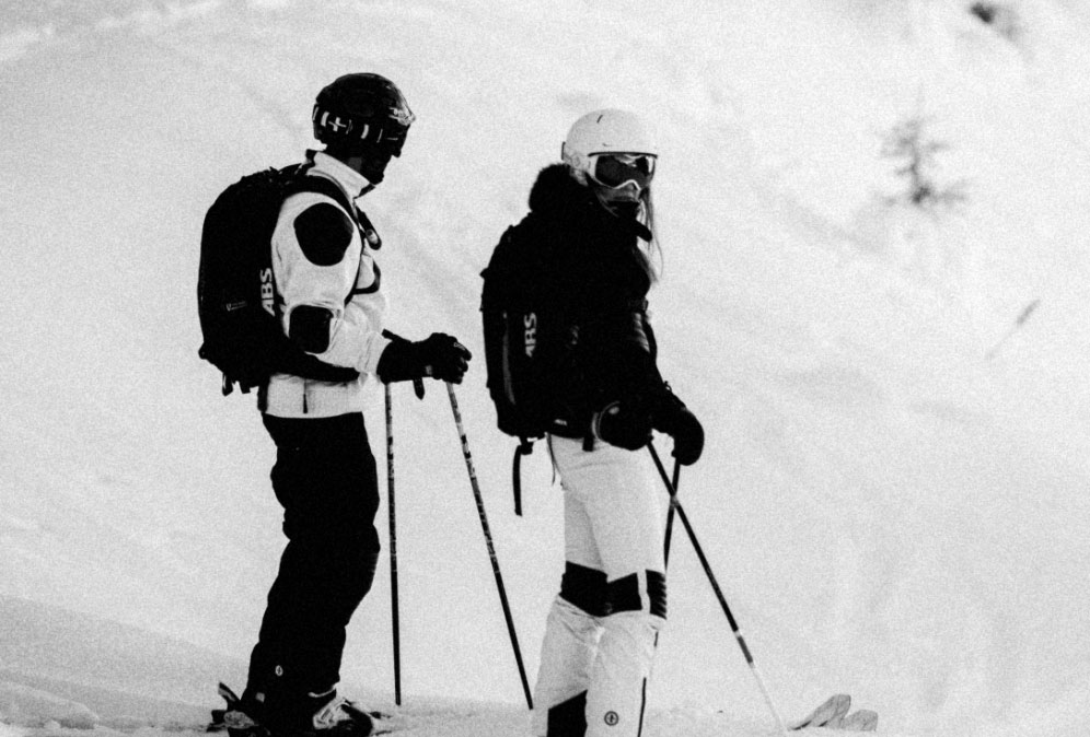 Black & white skier image with 2 Skiers on the slopes.
