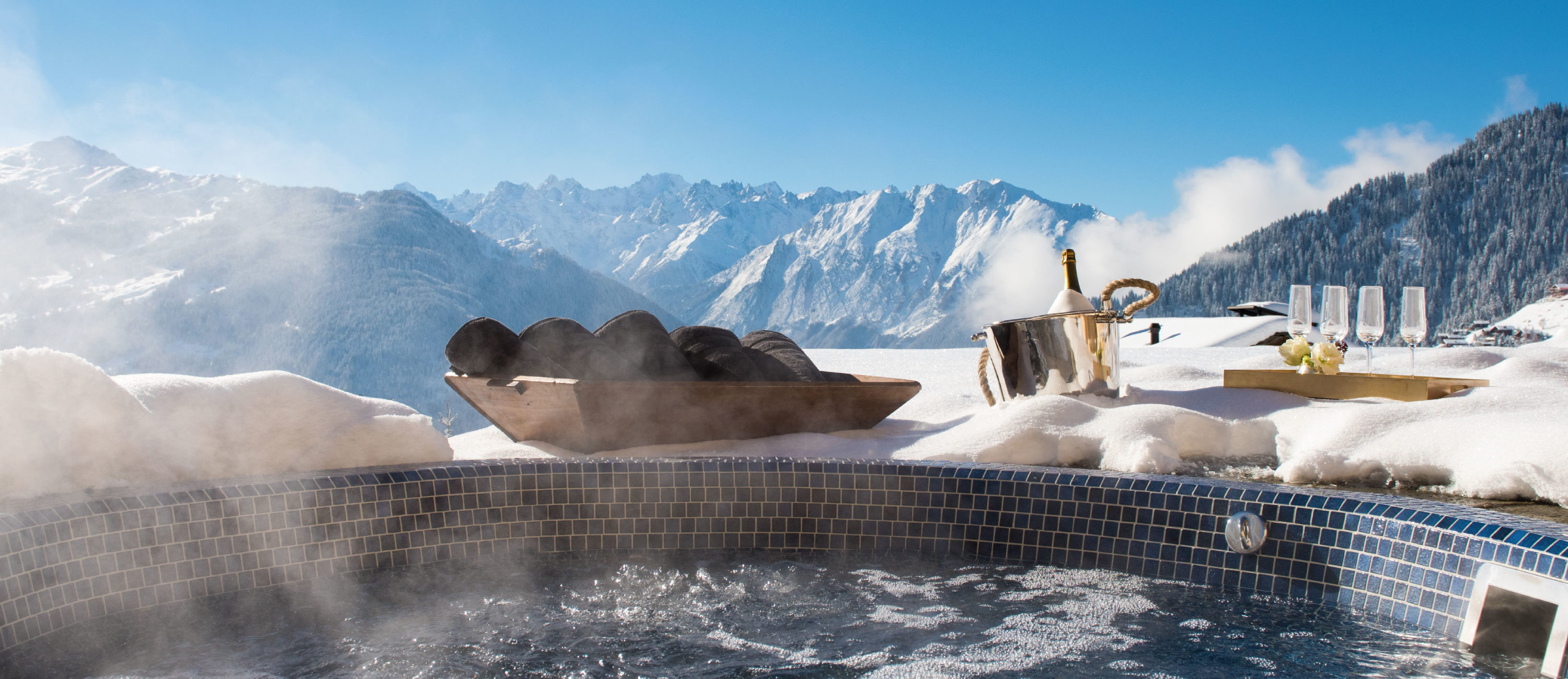 Outdoor hot tub with mountain views at Chalet Chouqui