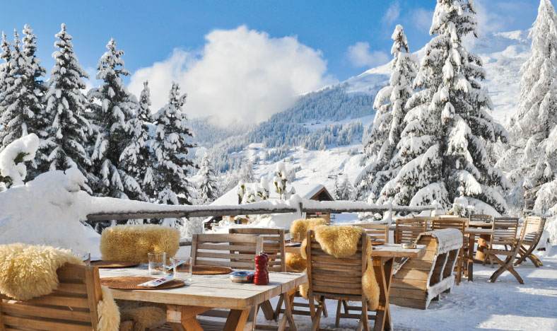 Al fresco dining in Verbier in the snow on sun terrace