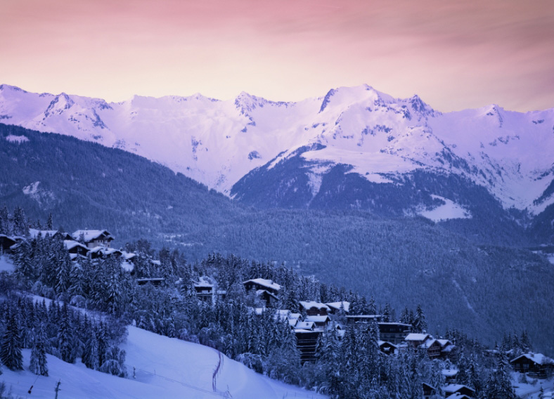 Sunset over luxury ski chalets in Courchevel