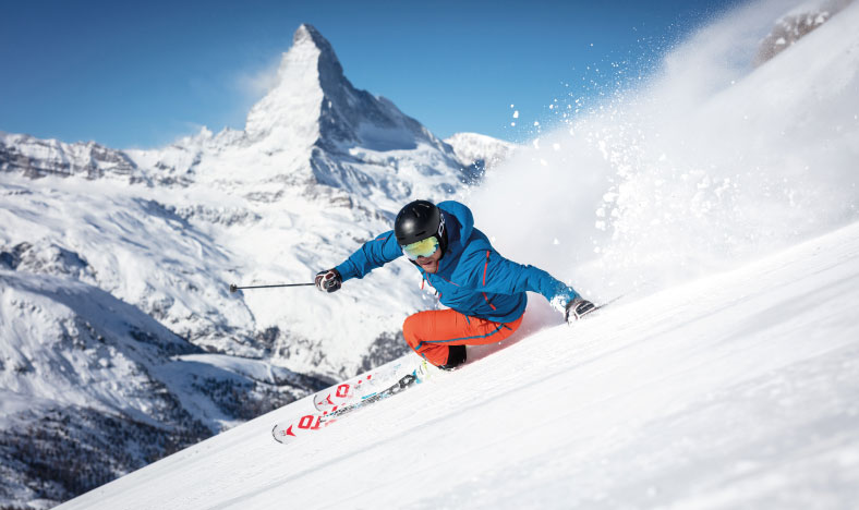 Skier in Zermatt with Matterhorn behind
