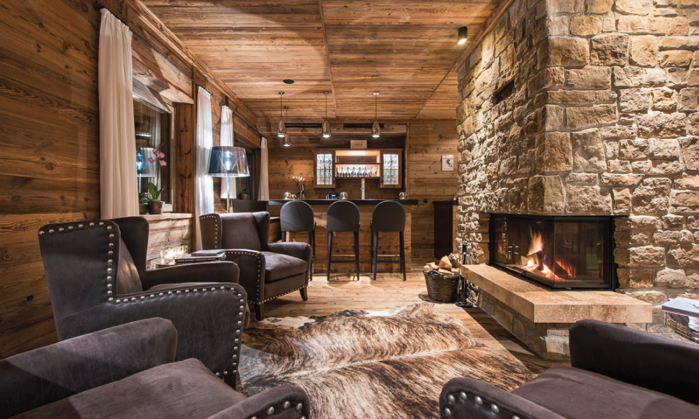 Eden Rock Private Bar Area with Open Fireplace. Perfect for corporate ski trips and travel