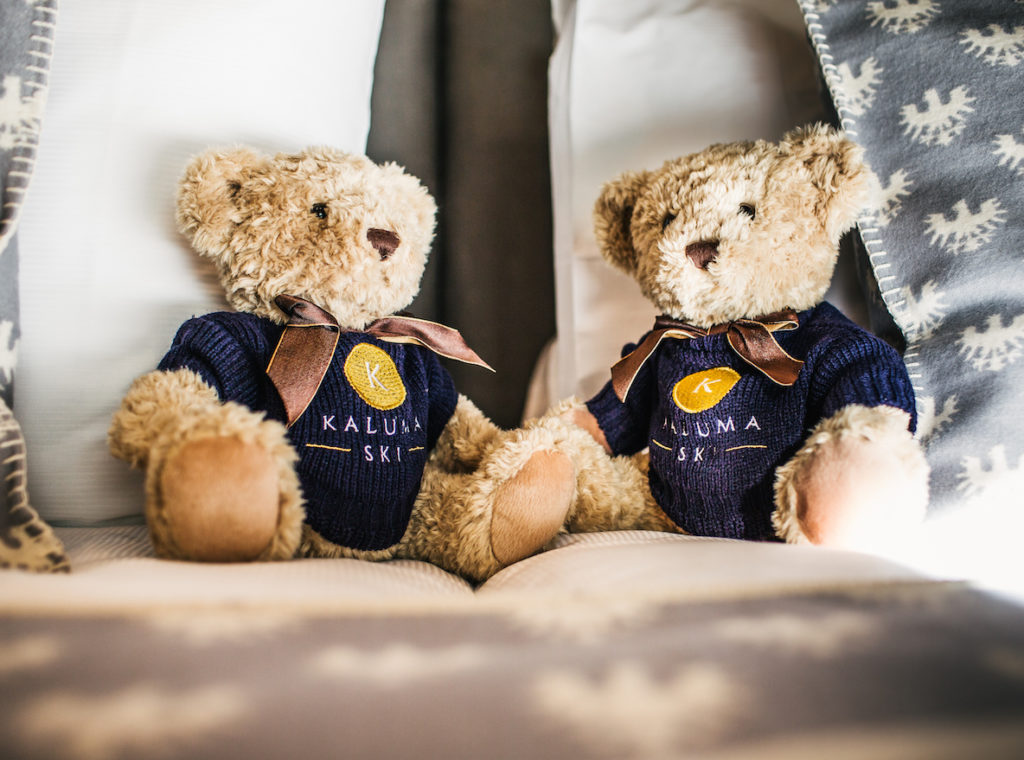 Kaluma Teddy bears sat on the bed in Chalet 47
