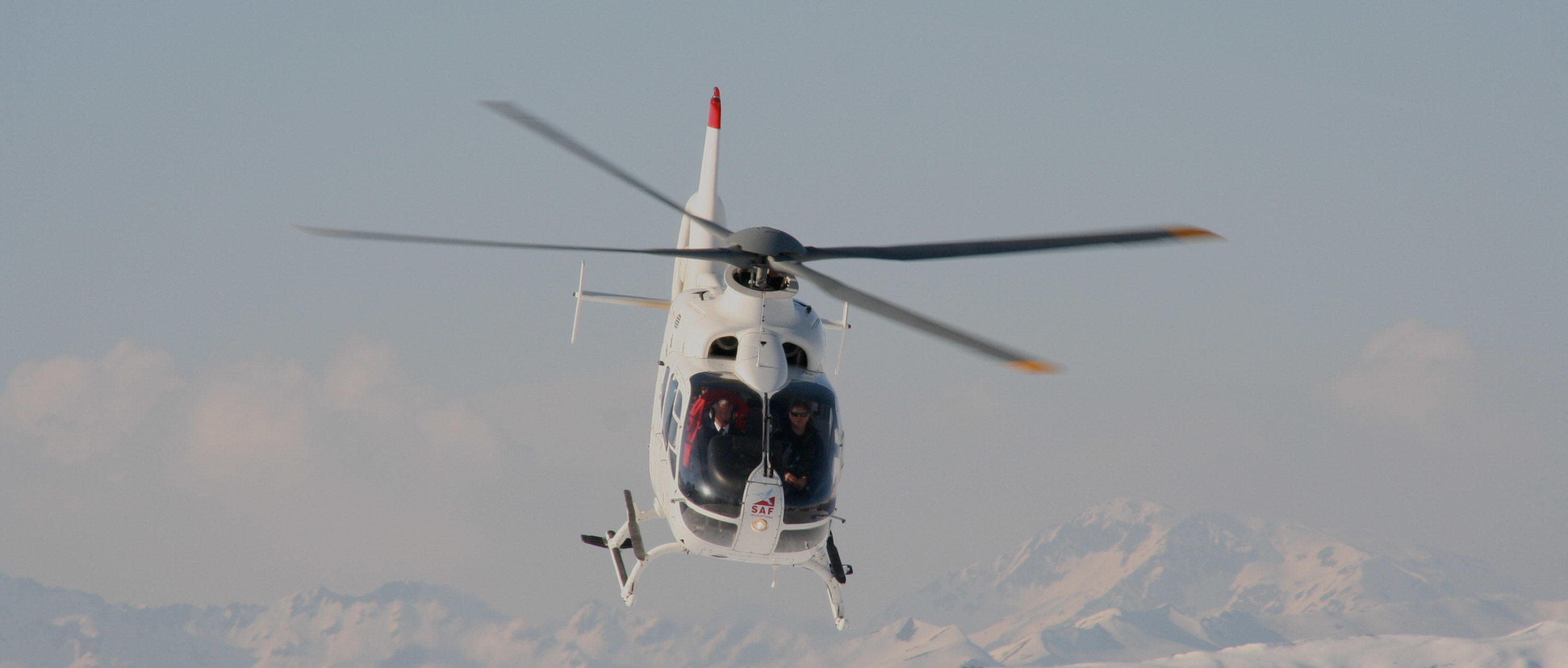Heli-Skiing in Spain. Helicopter over mountains