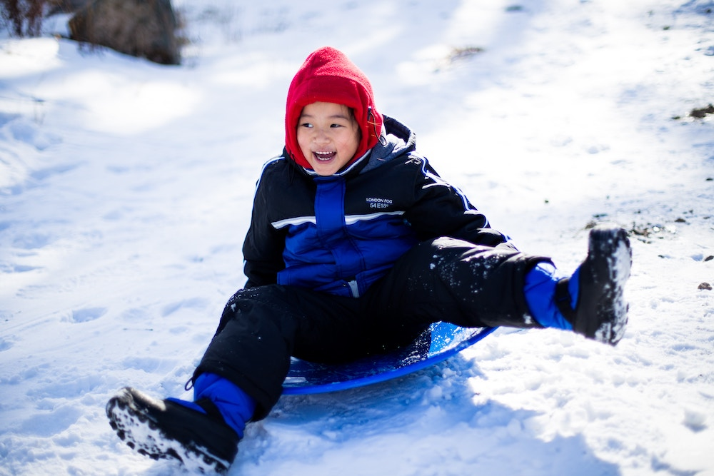 Family Skiing Activity Toboganning