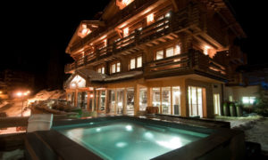 Outdoor hot tub and chalet view at The Lodge, Verbier