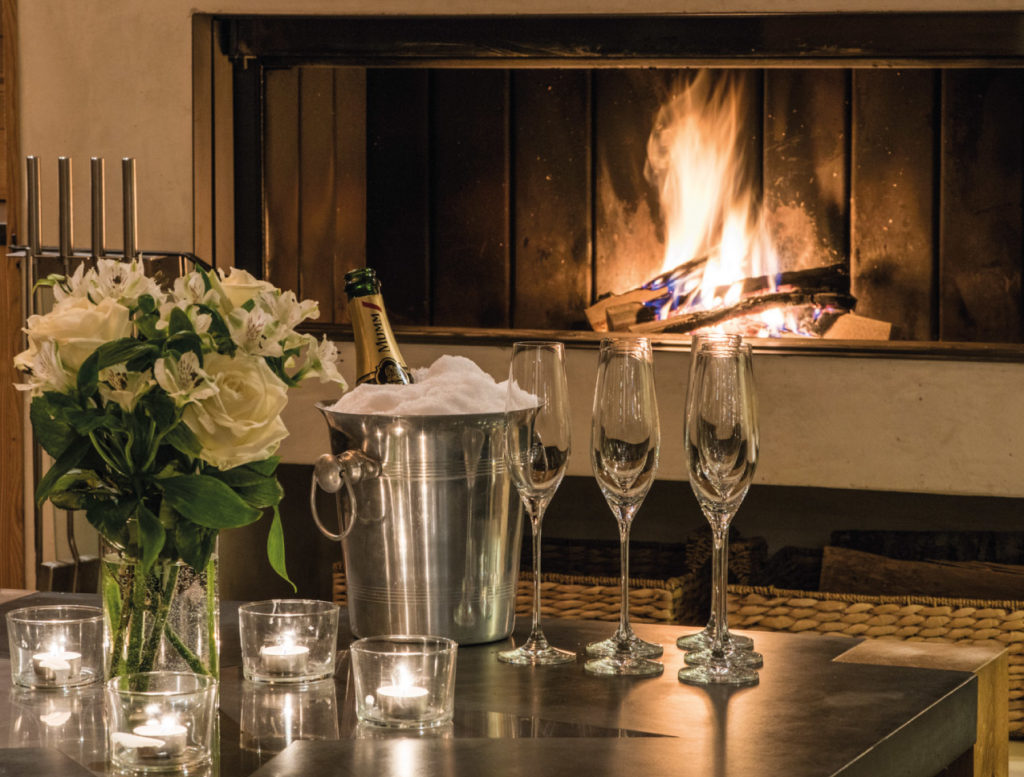 Champagne by the fire at Chalet Rock, Verbier