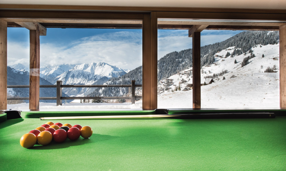 Pool table with mountain view at Chalet Rock in Verbier