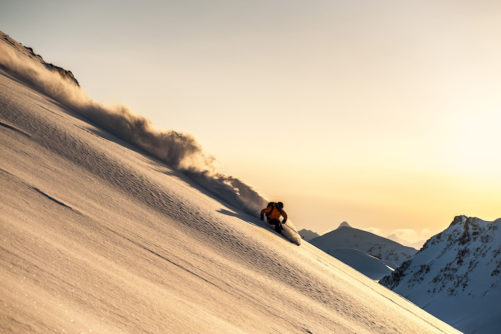 Last Frontier Heliskiing - Skier at Sunset