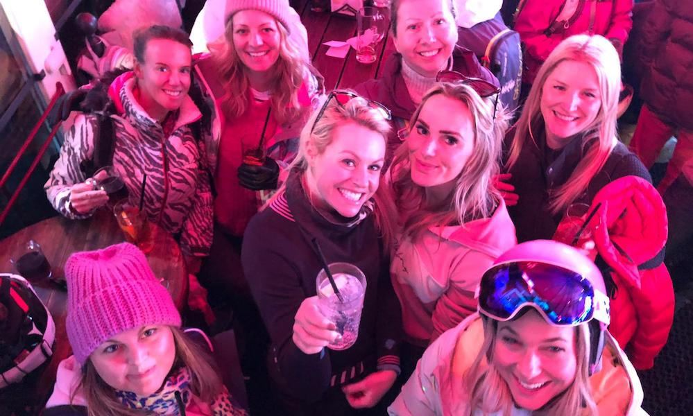 Chemmy Alcott with women who ski group at apres ski