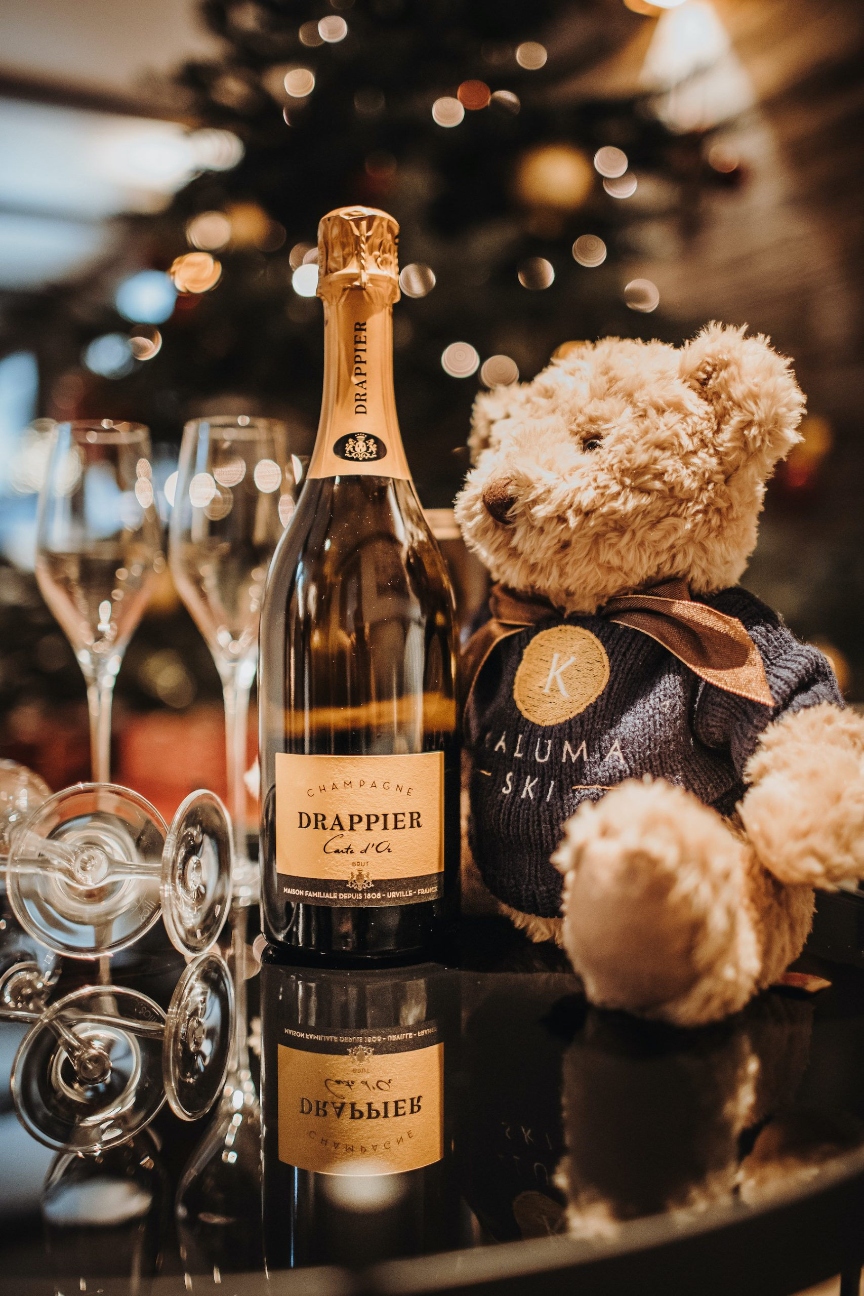 Merry Christmas in chalet 47 with a kaluma bear and champagne