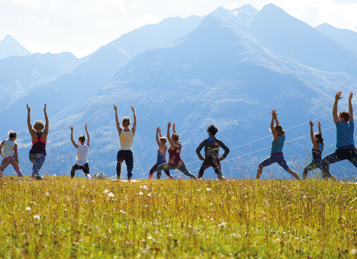 Yoga on top of a mountain in St Anton
