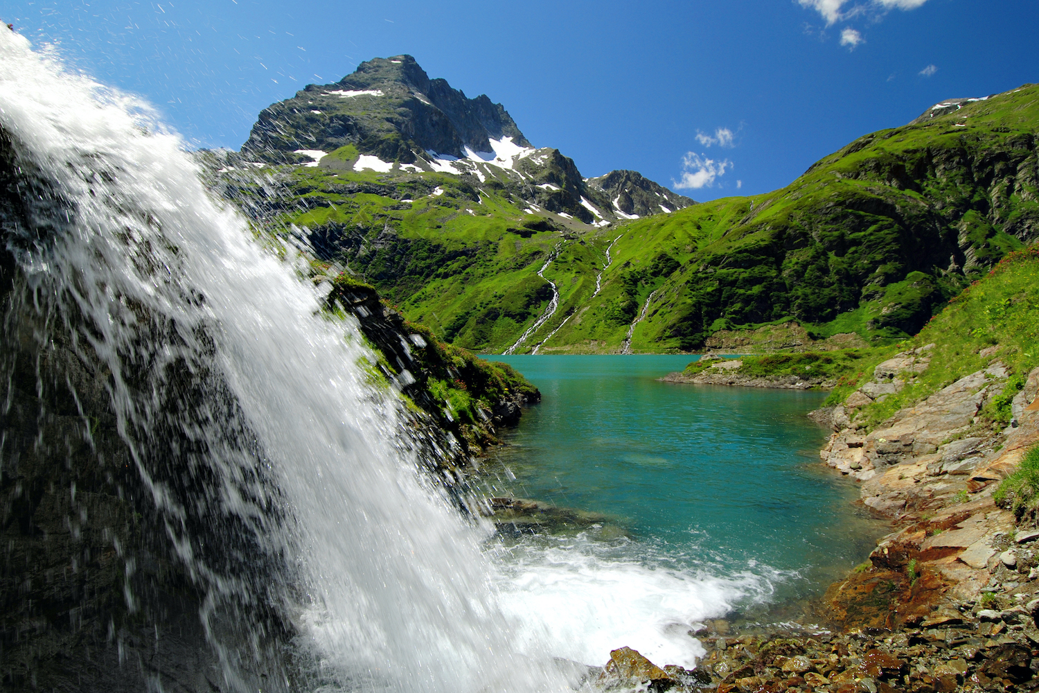 waterfall in summer in the alps