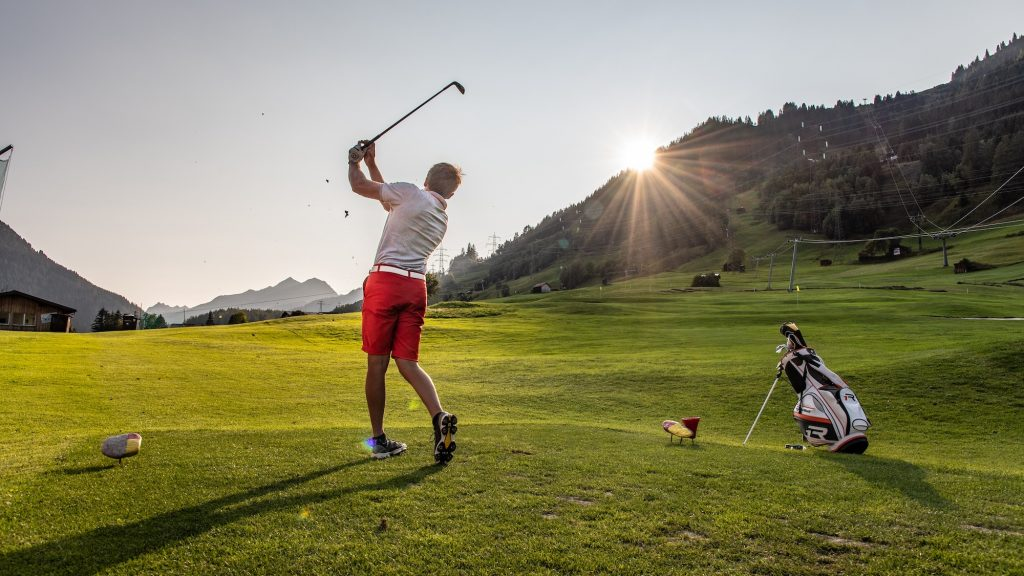Playing golf on a summer corporate trip